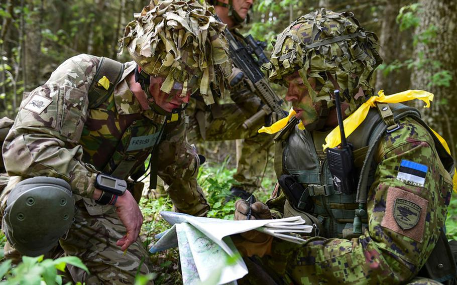 British and Estonian soldiers discuss battle plans during Steadfast Javelin 1 in southern Estonia. The exercise, which is being held to test military capabilities of NATO members, includes troops from nine nations. The exercise ends on Friday, May 23.   Andrew Davis/U.S. Air Force
