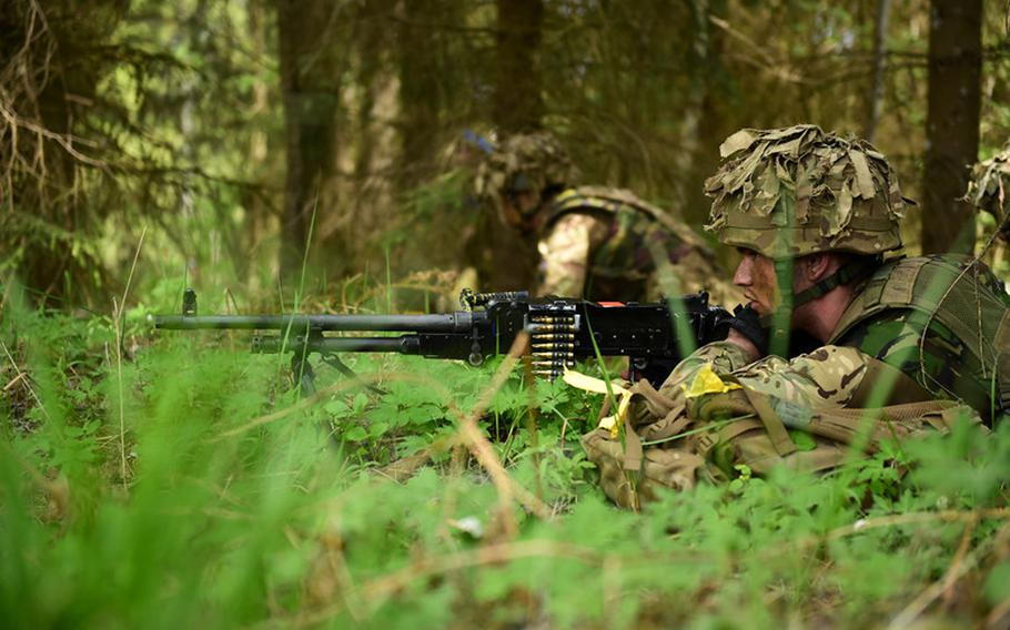A British soldier scans the landscape during war game exercises in southern Estonia. NATO's Steadfast Javelin 1 is being held at a time of unrest in Ukraine, which has unsettled allies in the Baltics and in eastern Europe.