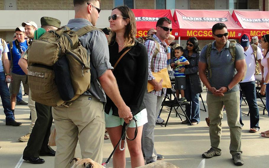 Capt. Colin Culkin says goodbye to his girlfriend, Lindsay Birtcil, and their dog, Whirley Bird, Friday, May 23, 2014, at Camp Pendleton, California. Culkin deployed to Afghanistan with 1st Air Naval Gunfire Liaison Company.