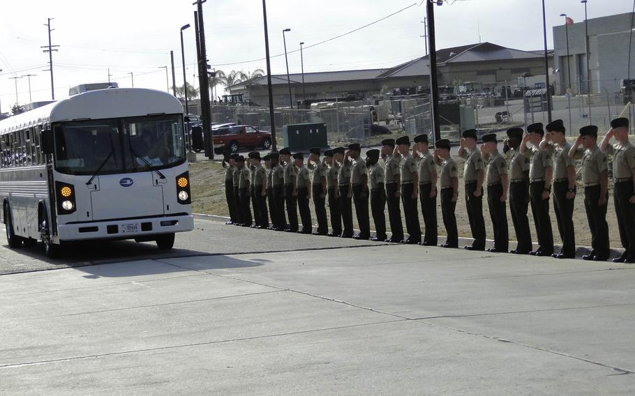 Marines with 1st Air Naval Gunfire Liaison Company sent their fellow Marines off to Afghanistan with a salute on Friday, May 23, 2014 at Camp Pendleton, California.