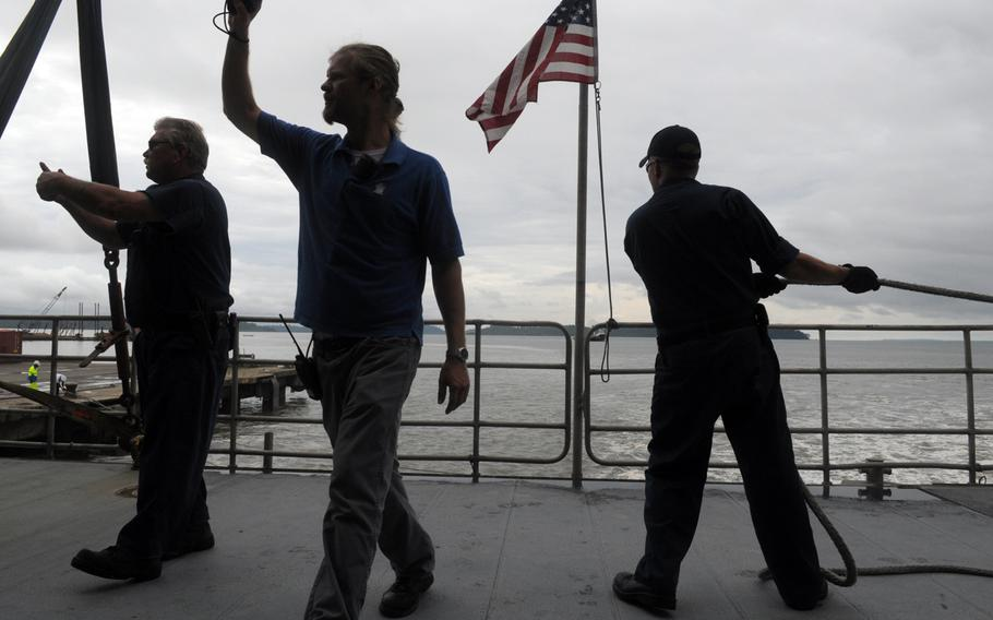 USNS Spearhead 3rd Mate Dustin Mailloux, center, works with fellow civilian mariner Jack Karg, left, and Petty Officer 1st Class Joshua Edwards to moor the Navy catamaran into port in Libreville, Gabon, on April 23, 2014. With too few warships to meet the demands of combatant commanders, the Navy is increasingly turning to civilian and contract mariners with the Military Sealift Command to accomplish its missions.