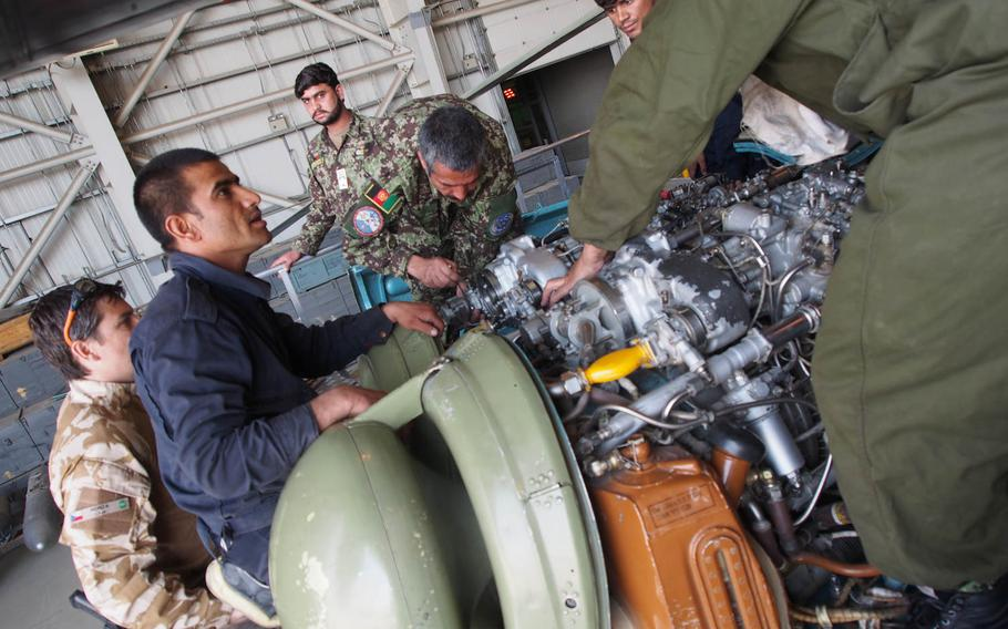 Afghan Air Force personnel perform maintenance on a helicopter while under the watch of Czech advisors. With no guarantees that foreign troops will be in Afghanistan past the end of the year, NATO trainers are trying to get the air force self-sustaining by the end of 2014.