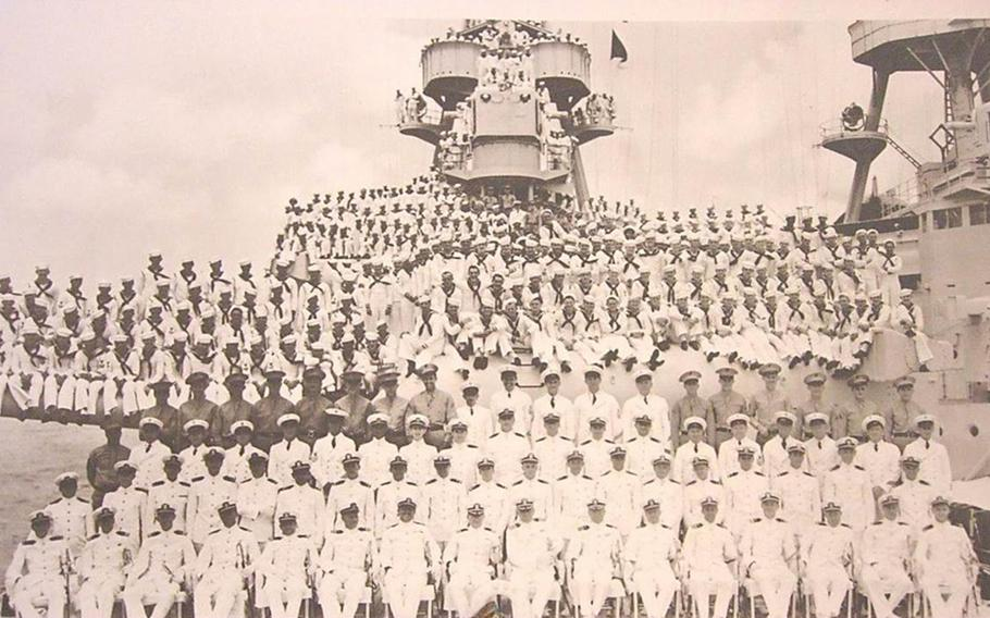 The crew of the USS Houston poses for a photograph on deck sometime prior to the start of World War II.