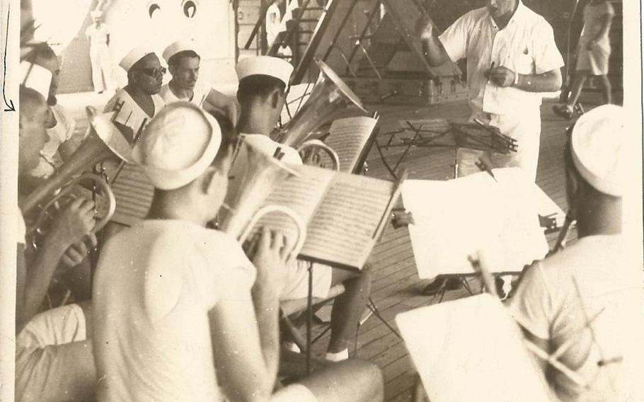 Marlene McCain found this photograph of the USS Houston's band playing on the ship's quarterdeck in a box of letters that her father, band member R. Edgar Morris, had sent home and were saved by her grandmother. Morris can be seen on the left hand side with an arrow pointing to him. The photograph can be dated sometime between March 29 and Sept. 19, 1941.