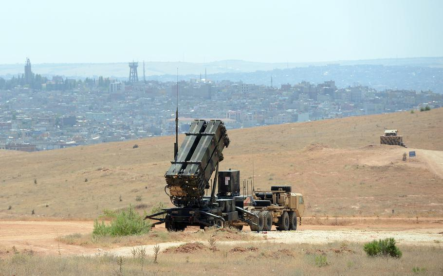 A Patriot missile launcher of the 3rd Battalion, 2nd Air Defense Artillery, sits on a hill overlooking Gaziantep, Turkey, and in the distance, Syria, in August 2013. Gaziantep, a border city, is one of the towns that has been frequently used by foreign fighters along the way to Syria.