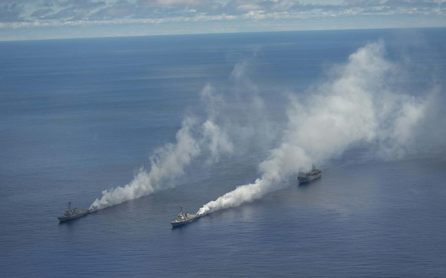 USS Mustin, USS Meyer and USS Cable test a carbon fiber-based obscurant fog south of Guam in late June to test its potential effectiveness against anti-ship missiles.