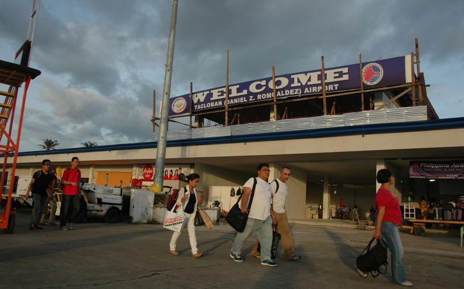 Passengers arrive at Tacloban's airport in July. Repairs at the terminal, all but destroyed in during Typhoon Haiyan eight months ago, are almost complete.