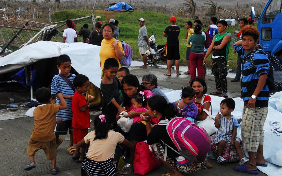 Young Filipino typhoon survivors wait for evacuation at Guiuan Airport in November 2013.