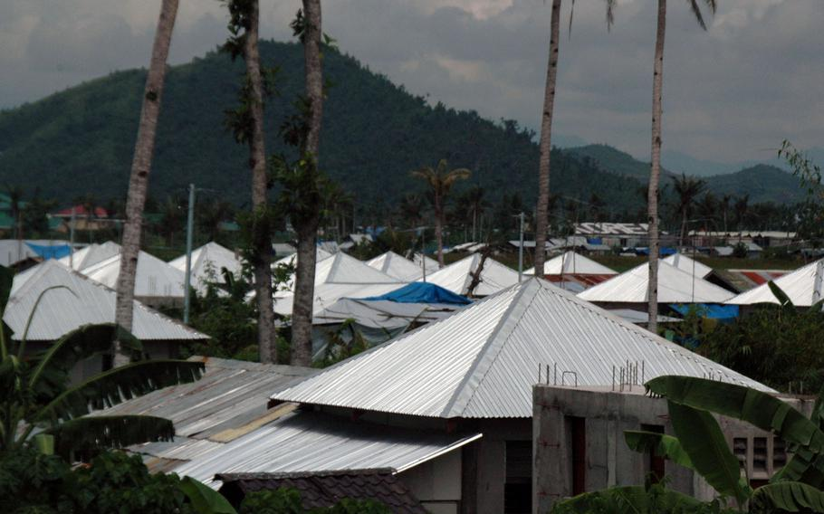 New homes are rapidly rising in Tacloban to house victims of last year's Typhoon Haiyan.