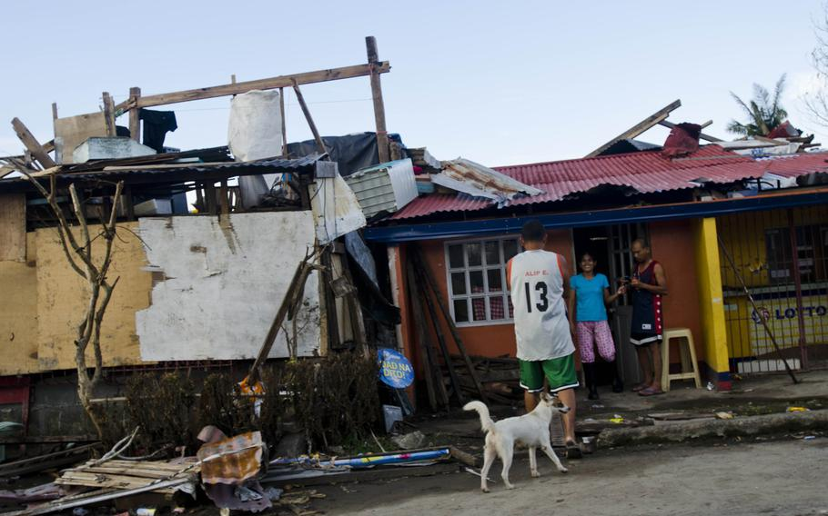 Victims of Typhoon Haiyan in and around Tacloban, Philippines were trying to piece their lives back together nearly two weeks after the disaster struck their city in November 2013.