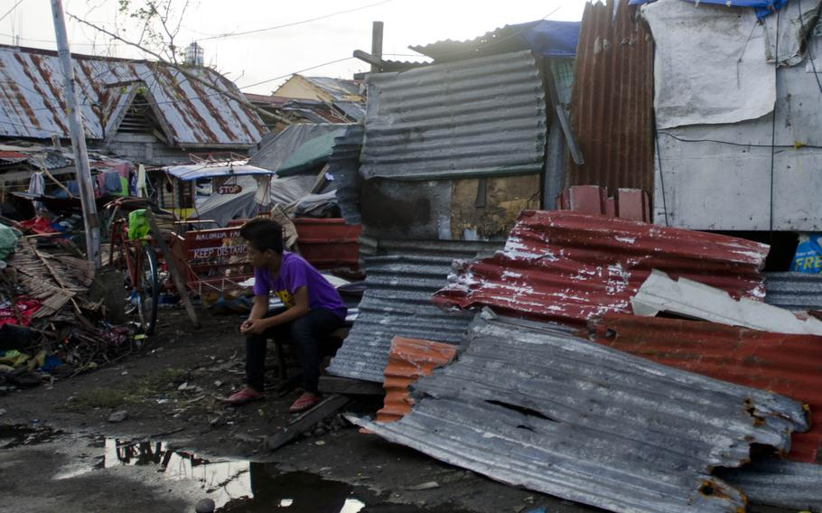 Victims of Typhoon Haiyan in and around Tacloban, were still trying to piece their lives back together nearly two weeks after the disaster struck their city in November 2013.