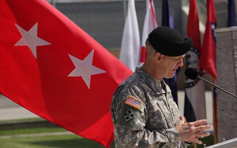 Lt. Gen. Donald M. Campbell Jr. speaks at a ceremony welcoming German Gen. Markus Laubenthal as U.S. Army Europe's first non-U.S. chief of staff, on Aug. 28, 2014.