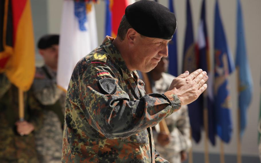 German Brig. Gen. Markus Laubenthal, U.S. Army Europe's new chief of staff, salutes after donning the command's soldier sleeve insignia, visible on his right sleeve, on Aug. 28, 2014.
