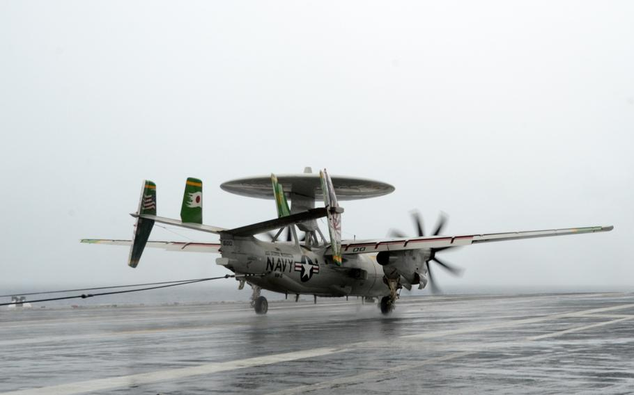 An E2-C Hawkeye lands aboard the USS George Washington in water near Guam on Sept. 17, 2014. The aircraft is participating in Valiant Shield 2014, this year's largest U.S.-only military exercise.