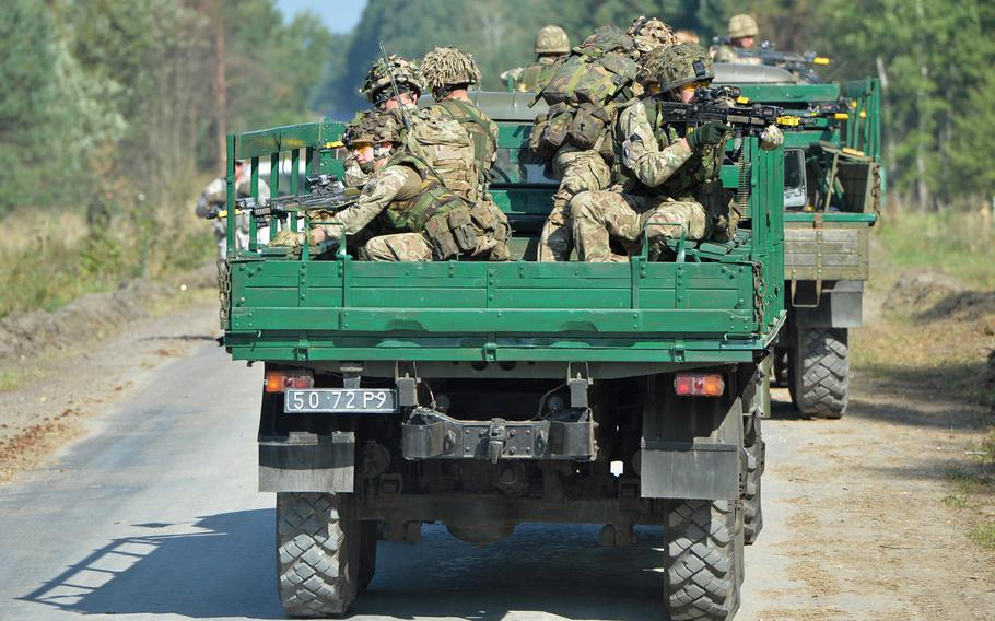 British soldiers keep alert during convoy training at Exercise Rapid Trident near Yavoriv, Ukraine, Wednesday, Sept. 17, 2014. About 1,300 troops are taking part in the exercise, which comes during a time of war for Ukraine.