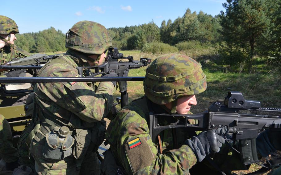 Lithuanian soldiers look for danger during convoy training at Exercise Rapid Trident near Yavoriv, Ukraine, Wednesday, Sept. 17, 2014.