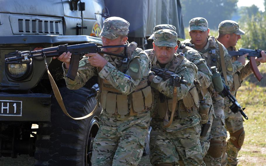 Georgian soldiers practice a drill during cordon-and-search training at Exercise Rapid Trident near Yavoriv, Ukraine, Thursday, Sept. 18, 2014.