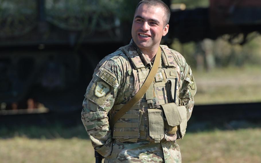 Lt. Beka Metreveli, a Georgian platoon leader, watches as fellow soldiers go through training at Exercise Rapid Trident near Yavoriv, Ukraine, Thursday, Sept. 18, 2014.