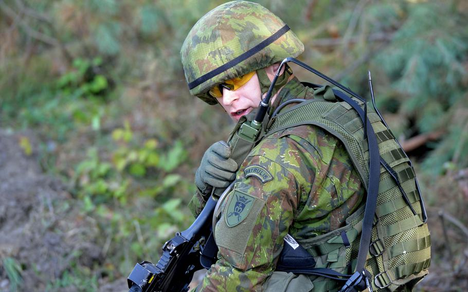 A Lithuanian army platoon leader radios during convoy training at Exercise Rapid Trident near Yavoriv, Ukraine, Wednesday, Sept. 17, 2014.