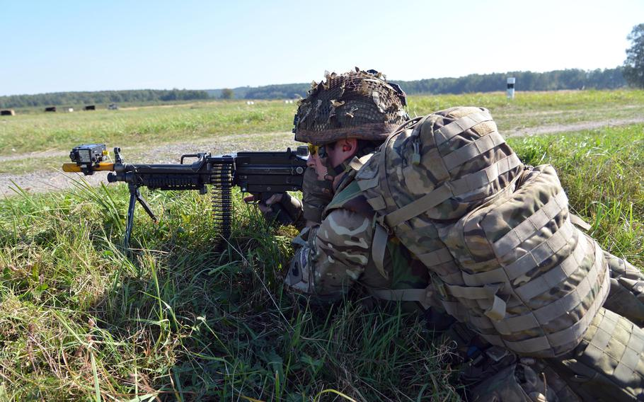 A British soldiers guards the perimeter during training at Exercise Rapid Trident near Yavoriv, Ukraine, Thursday, Sept. 18, 2014.