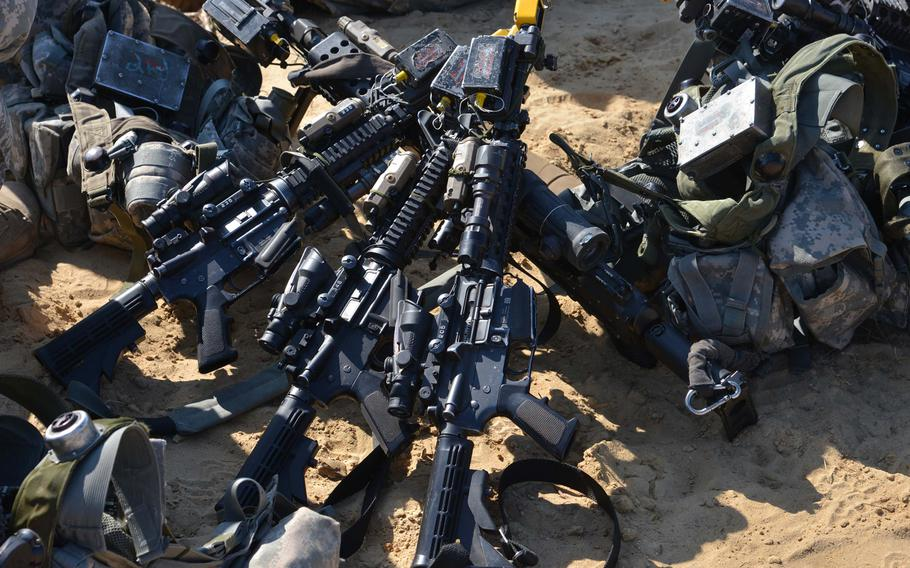 Weapons and gear of 173rd Airborne Brigade soldiers sit in the sand at Exercise Rapid Trident near Yavoriv, Ukraine, Wednesday, Sept. 17, 2014. Fifteen counties are taking part in the exercise that lasts until Sept. 26.