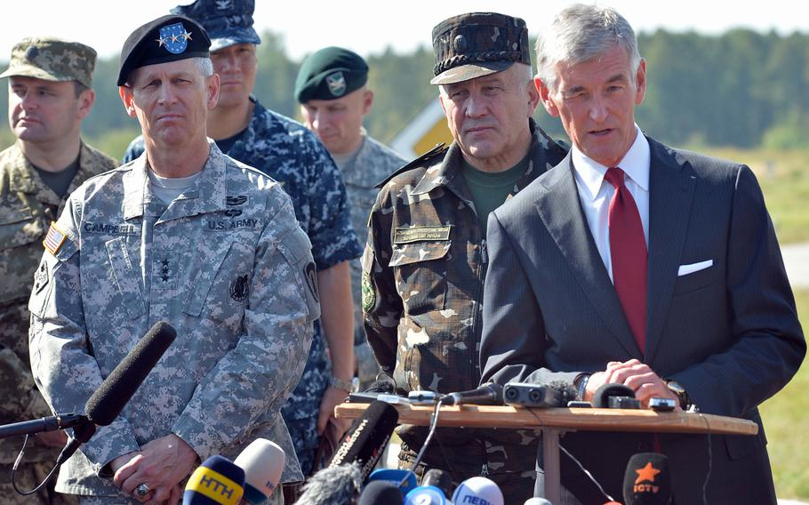 USAREUR commander Lt. Gen. Donald Campbell and Lt. Gen. Anatoliy Pushniakov, Ukrainian land forces commander, listen as Secretary of the Army John McHugh answers a journalist's question at Exercise Rapid Trident near Yavoriv, Ukraine, Friday, Sept. 19, 2014. About 1,300 troops from 15 countries are taking part in the exercise, which runs through Sept. 26.