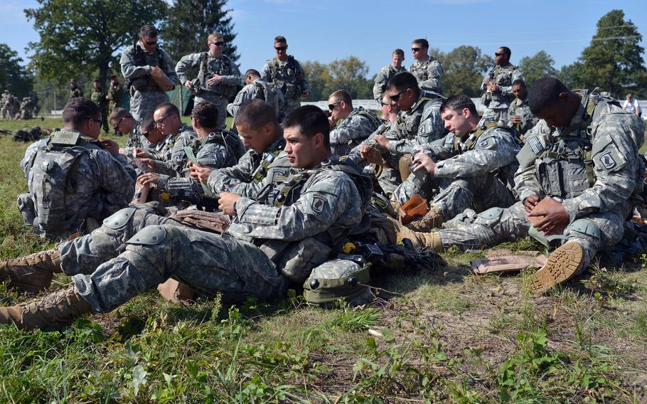 Soldiers of the 173rd Airborne Brigade have an MRE lunch after meeting Secretary of the Army John McHugh and USAREUR commander Lt. Gen. Donald Campbell  at Exercise Rapid Trident near Yavoriv, Ukraine, Friday, Sept. 19, 2014. It was media and VIP day at the exercise. About 1,300 troops from 15 countries are taking part in the exercise, which runs through Sept. 26.