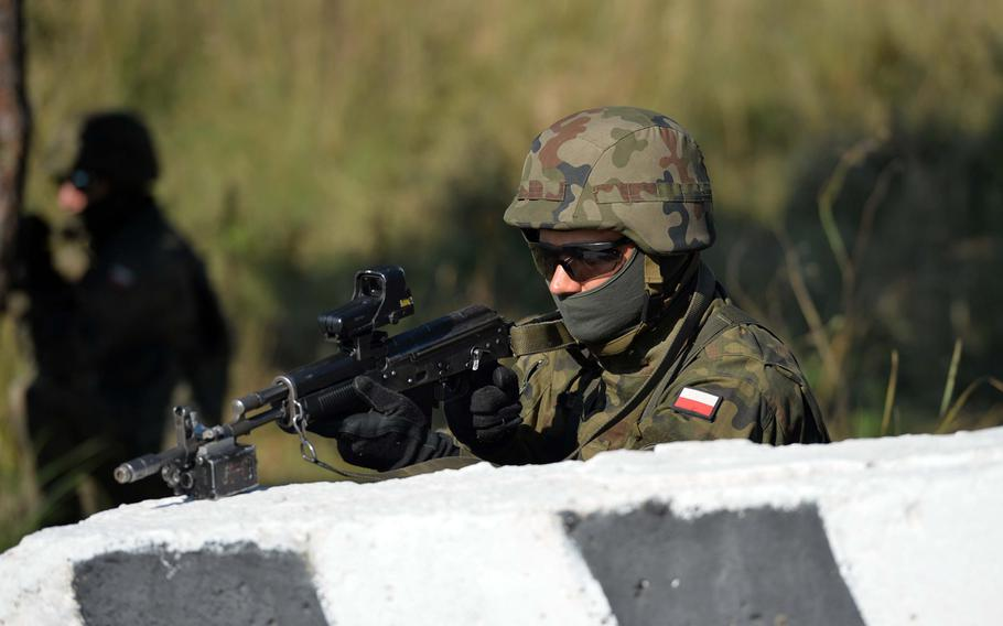A Polish soldier guards the perimeter during a cordon-and-search exercise at Exercise Rapid Trident near Yavoriv, Ukraine, Friday, Sept. 19, 2014. Friday was media and VIP day at the exercise. Among the dignitaries watching the action were Secretary of the Army John McHugh, USAREUR commander Lt. Gen. Donald Campbell and Lt. Gen. Ben Hodges, commander NATO Allied Land Command.