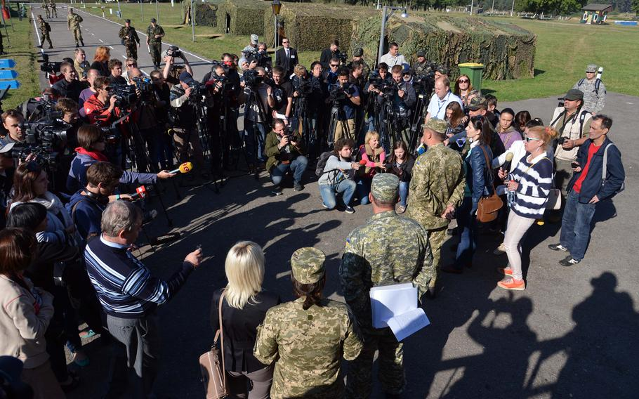 Journalists are briefed by soldiers at Exercise Rapid Trident near Yavoriv, Ukraine, Friday, Sept. 19, 2014. It was media and VIP day at the exercise and. Among the dignitaries watching the action were Secretary of the Army John McHugh, USAREUR commander Lt. Gen. Donald Campbell and Lt. Gen. Ben Hodges, commander NATO Allied Land Command. About 1,300 troops from 15 countries are taking part in the exercise, which runs through Sept. 26.