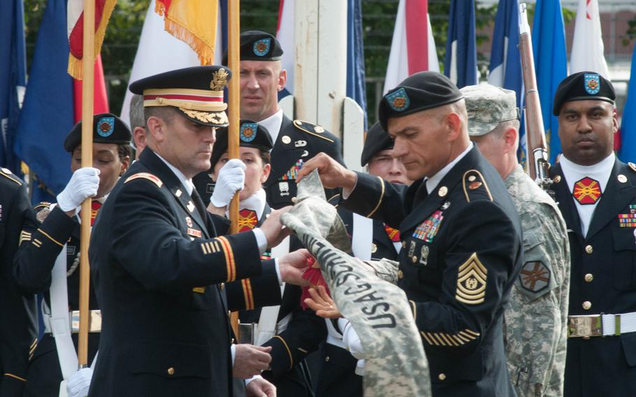 U.S. Army Garrison Ansbach commander Col. Christopher Benson and Command Sgt. Maj. Mark Kiefer case the Schweinfurt garrison colors at the base's closure ceremony, Sept. 19, 2014.