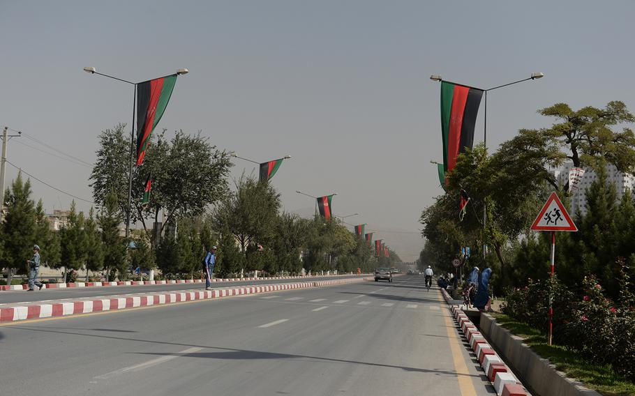 Afghan flags line Airport Road in Kabul on Sunday, Sept. 28, 2014 ahead of Monday's presidential inauguration ceremony. Ashraf Ghani will be sworn in as the new head of state after a bruising five-month electoral battle.