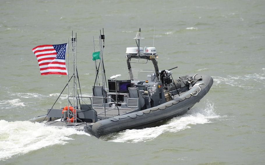 An unmanned 11-meter rigid hulled inflatable boat (RHIB) from Naval Surface Warfare Center Carderock operates autonomously during an Office of Naval Research (ONR)-sponsored demonstration of swarmboat technology held on the James River in Newport News, Va. During the demonstration as many as 13 Navy boats, using an ONR-sponsored system called CARACaS (Control Architecture for Robotic Agent Command Sensing), operated autonomously or by remote control during escort, intercept and engage scenarios.