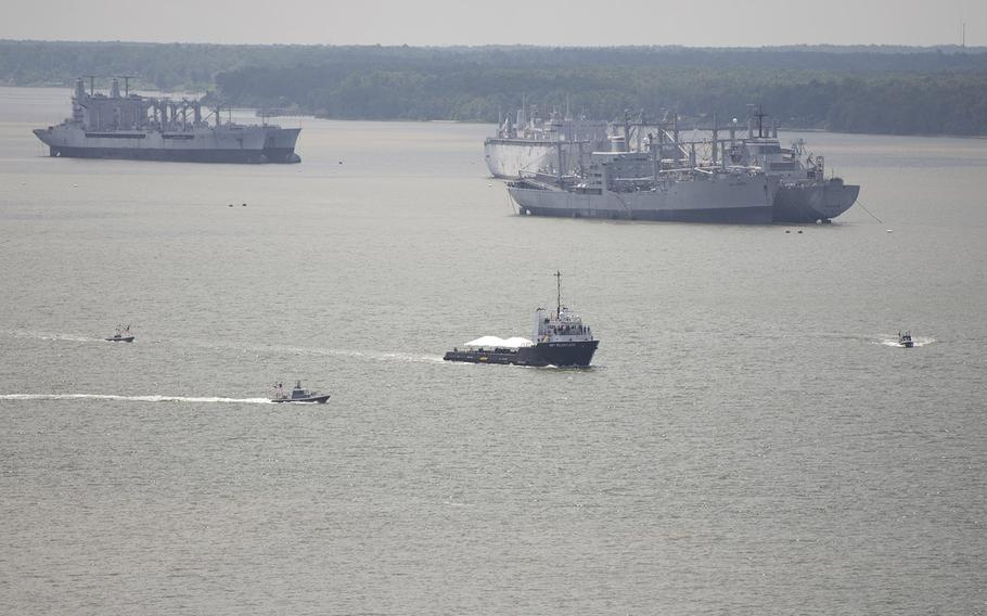 Unmanned surface vehicles (USVs) operate autonomously while escorting a high-value unit during an Office of Naval Research (ONR)-sponsored demonstration of swarmboat technology held on the James River in Newport News, Va. During the demonstration as many as 13 Navy boats, using an ONR-sponsored system called CARACaS (Control Architecture for Robotic Agent Command Sensing), operated autonomously or by remote control during escort, intercept and engage scenarios.