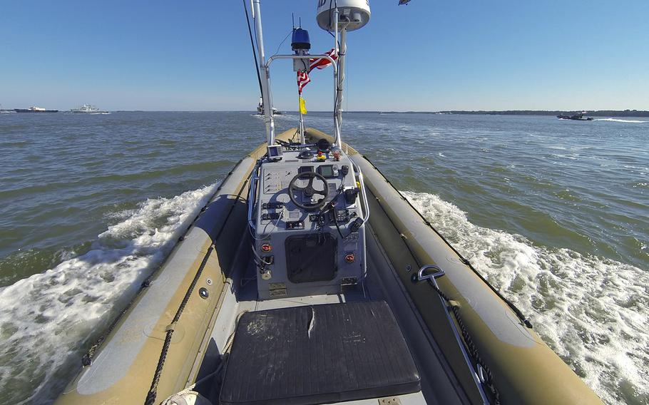 An unmanned seven meter rigid hulled inflatable boat (RHIB) operates autonomously during an Office of Naval Research (ONR)-sponsored demonstration of swarmboat technology held on the James River in Newport News, Va. During the demonstration as many as 13 Navy boats, using an ONR-sponsored system called CARACaS (Control Architecture for Robotic Agent Command Sensing), operated autonomously or by remote control during escort, intercept and engage scenarios.