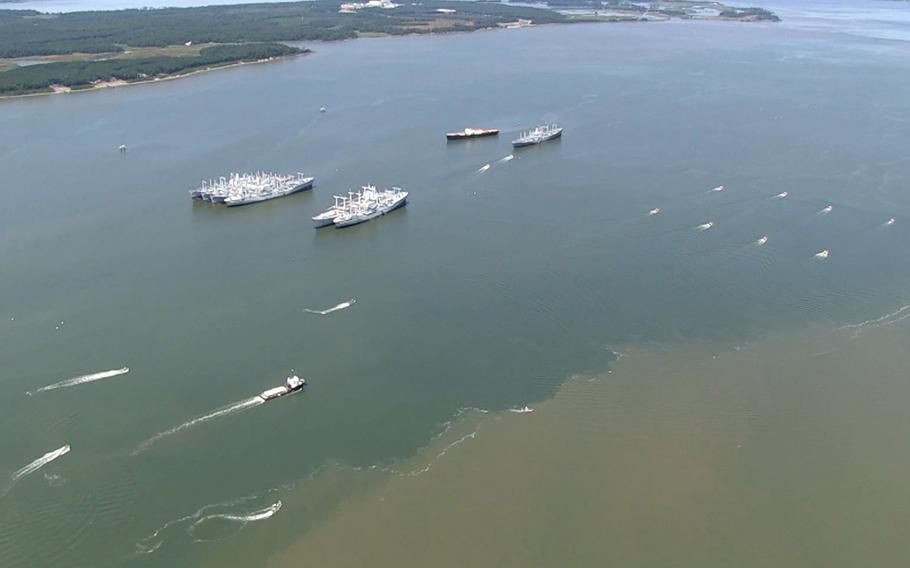 In a screen capture from video, eight unmanned high-speed maneuvering surface targets (HSMSTs), right, lead the way as five unmanned autonomous vehicles (USVs) escort a high-value asset during an Office of Naval Research (ONR)-sponsored demonstration of autonomous swarmboat technology held on the James River in Newport News, Va. During the demonstration as many as 13 Navy boats, using an ONR-sponsored system called CARACaS (Control Architecture for Robotic Agent Command Sensing), operated autonomously or by remote control during escort, intercept and engage scenarios.