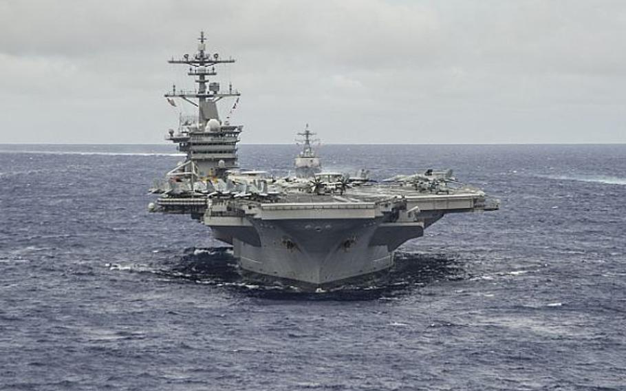 The Nimitz-class aircraft carrier USS Carl Vinson underway in formation in the Pacific Ocean, Sept. 23, 2014.