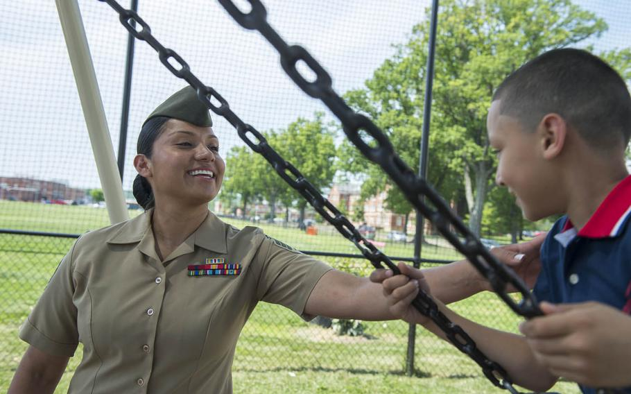 Marine Sgt. Jennifer Suarez pushes her son, Anthony, on a swing at Barnett Park in Quantico, Va., May 8, 2015. After a long road, Suarez beat brain cancer to return to active duty in the Marine Corps.
