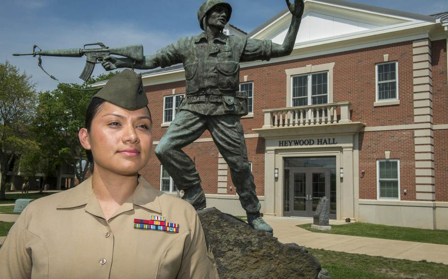 Marine Sgt. Jennifer Suarez stands in front of Haywood Hall at The Basic School in Quantico, Va., May 8, 2015. Suarez recently returned to active duty following a long battle with brain cancer.
