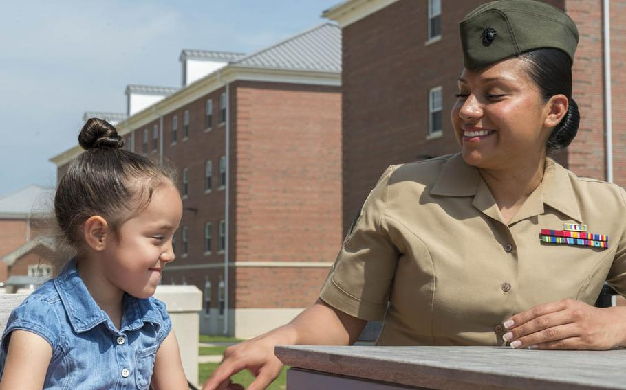 Marine Sgt. Jennifer Suarez laughs with her daughter during a visit to Marine Corps Base Quantico, Va., May 8, 2015. Suarez beat brain cancer to return to active duty.