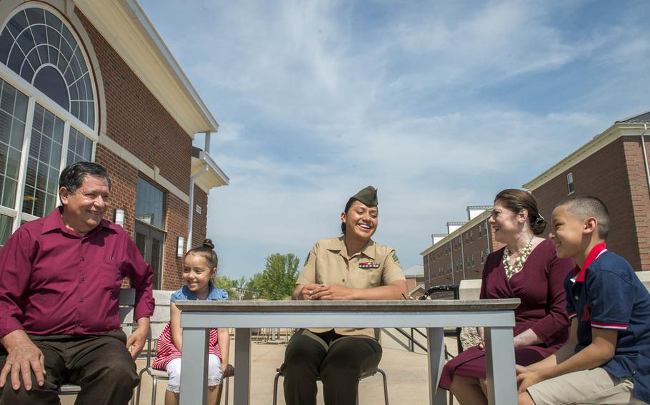 Marine Sgt. Jennifer Suarez, center, is surrounded by family during a recent visit to The Basic School at Quantico, Va., May 8, 2015. Suarez says she leaned heavily on her family to help her beat brain cancer and return to active duty.