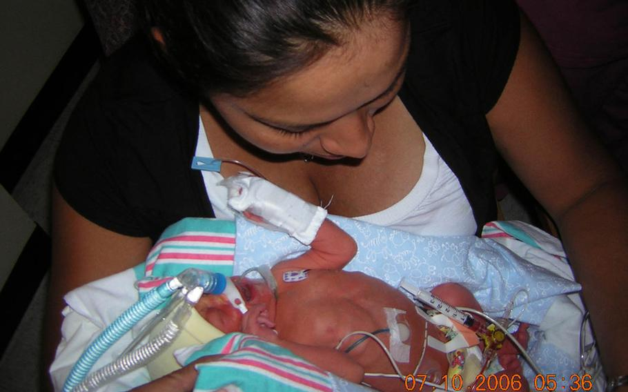 Marine Sgt. Jennifer Suarez holds her son, Anthony, on July 10, 2006, after he was born prematurely. Anthony's struggle with a failing heart and lungs mirrored her own battle against brain cancer, which was discovered shortly before his birth. The cancer has since gone into remission, and Suarez has returned to active duty in the Marine Corps. Anthony also recovered.