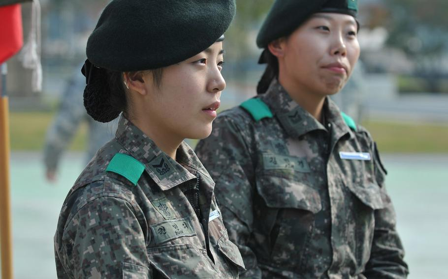 South Korean Staff Sgt. Kwon Minzy takes a break during the during Expert Infantryman Badge training last month at Camp Casey. Kwon, along with Staff Sgt. Kim Min Kyoung, became the first South Korean females to earn the badges.