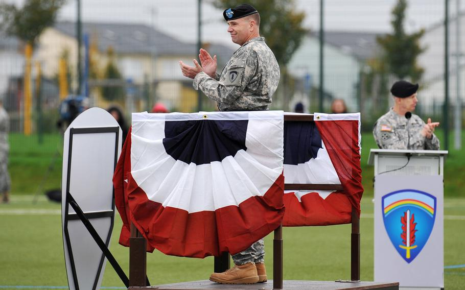 Incoming U.S. Army Europe commander Lt. Gen. Frederick ''Ben'' Hodges, foreground, and the outgoing commander, Lt. Gen. Donald Campbell Jr., applaud USAREUR troops at the unit's change-of-command ceremony in Wiesbaden, Germany, Wednesday, Nov. 5, 2014.