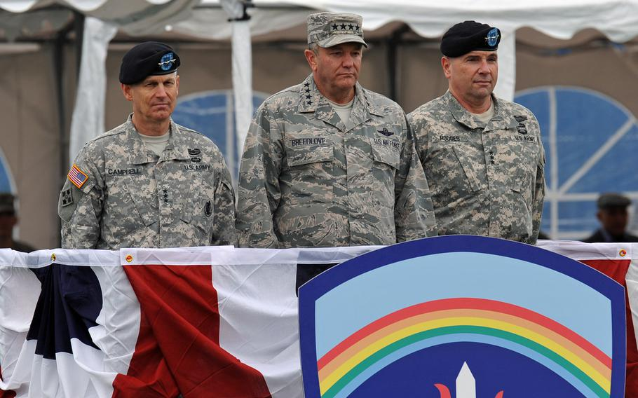 From left, outgoing U.S. Army Europe commander Lt. Gen. Donald Campbell Jr., EUCOM commander Gen. Philip Breedlove and incoming USAREUR commander Lt. Gen. Frederick ''Ben'' Hodges watch the proceedings at the change-of-command ceremony in Wiesbaden, Germany, Wednesday, Nov. 5, 2014.