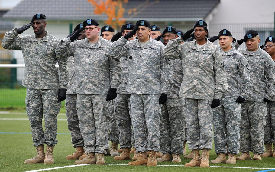U.S. Army Europe soldiers salute during the playing of the national anthem at the USAREUR change-of-command ceremony in Wiesbaden, Germany, Wednesday, Nov. 5, 2014. Lt. Gen. Frederick ''Ben'' Hodges took the reins from Lt. Gen. Donald Campbell Jr. at the ceremony.