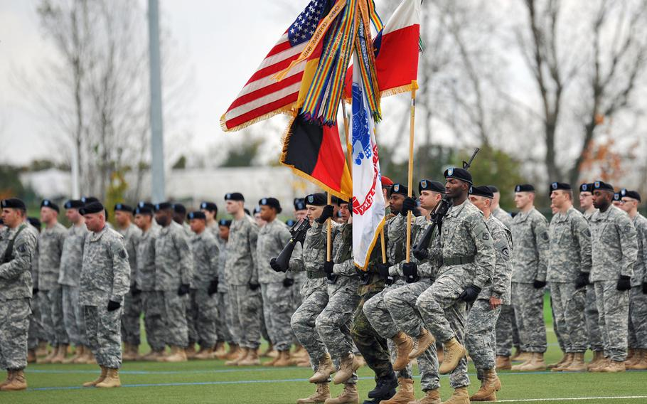 The honor guard marches in for the posting of the colors at the U.S. Army Europe change-of-command ceremony in Wiesbaden, Germany, Wednesday, Nov. 5, 2014.