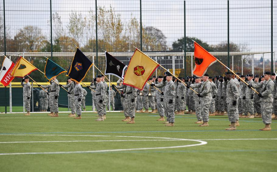 Soldiers representing U.S. Army Europe units stand during the rendering of honors at the USAREUR change-of-command ceremony in Wiesbaden, Germany, Wednesday, Nov. 5, 2014.