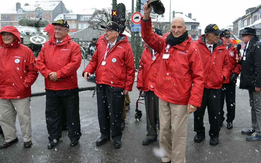 World War II veteran Steven Weiss waves to the crowd as he and other veterans prepare to attend a wreath-laying ceremony in Bastogne, Belgium, Dec. 13, 2014, that was part of commemorations marking the 70th anniversary of the Battle of the Bulge.