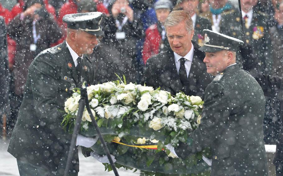King Philippe of Belgium lays a wreath on McAuliffe square in Bastogne, Belgium, Saturday, Dec. 13, 2014. The ceremony was part of commemorations marking the 70th anniversary of the Battle of the Bulge.