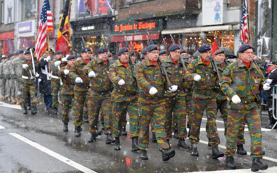 Belgian and American soldiers march up a Bastogne, Belgium, street during a ceremony that was part of commemorations marking the 70th anniversary of the Battle of the Bulge.